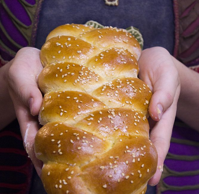 challah bread braid in hands