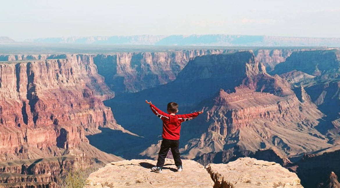 joe on the edge of the grand canyon