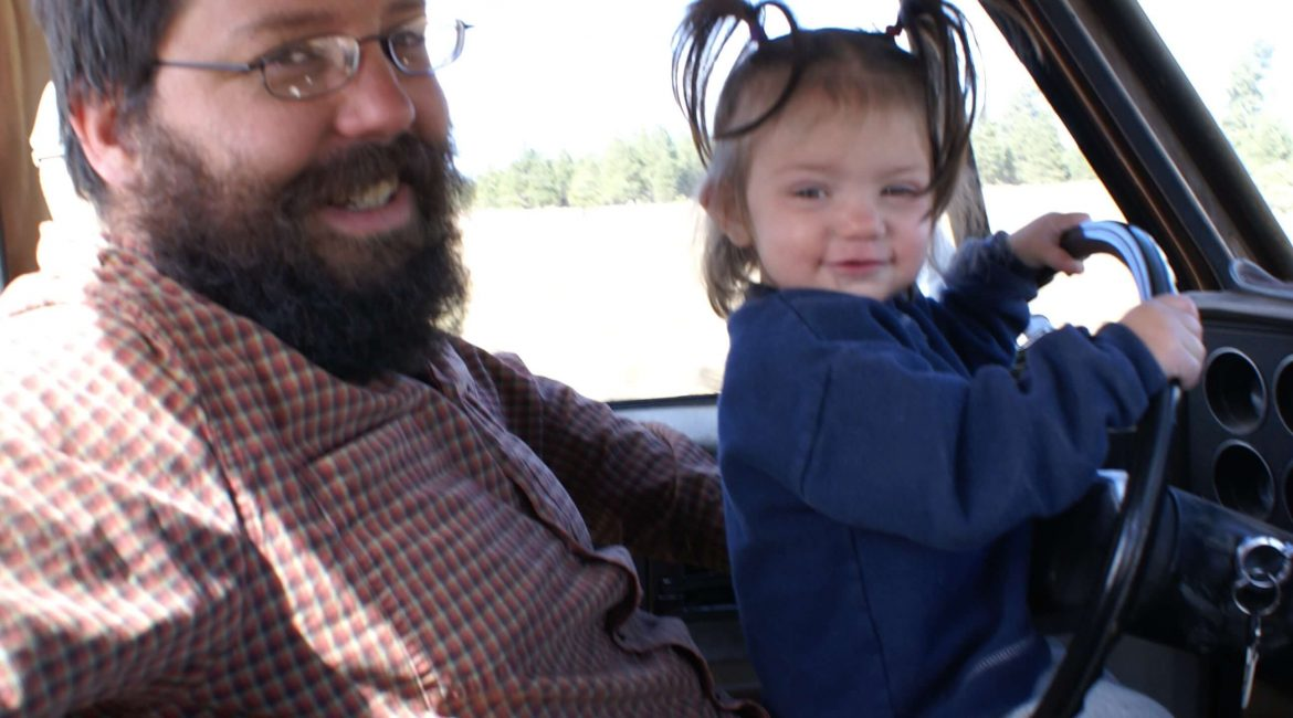 Daddy and little girl driving truck